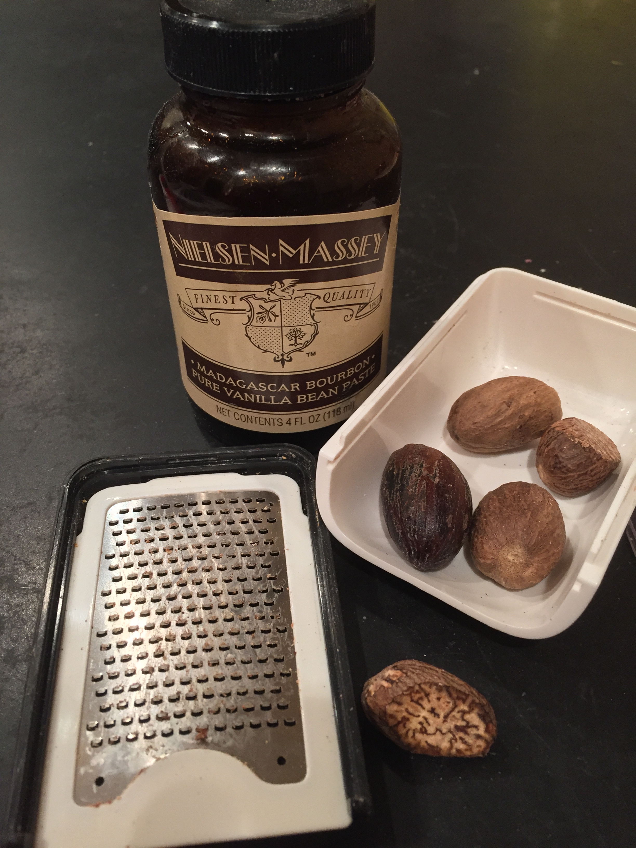 Nielsen-Massey Madagascar Bourbon Pure Vanilla Bean Paste hanging out with my nutmeg grater (yes, such a thing exists) and whole nutmegs. Aren't they cool looking inside?