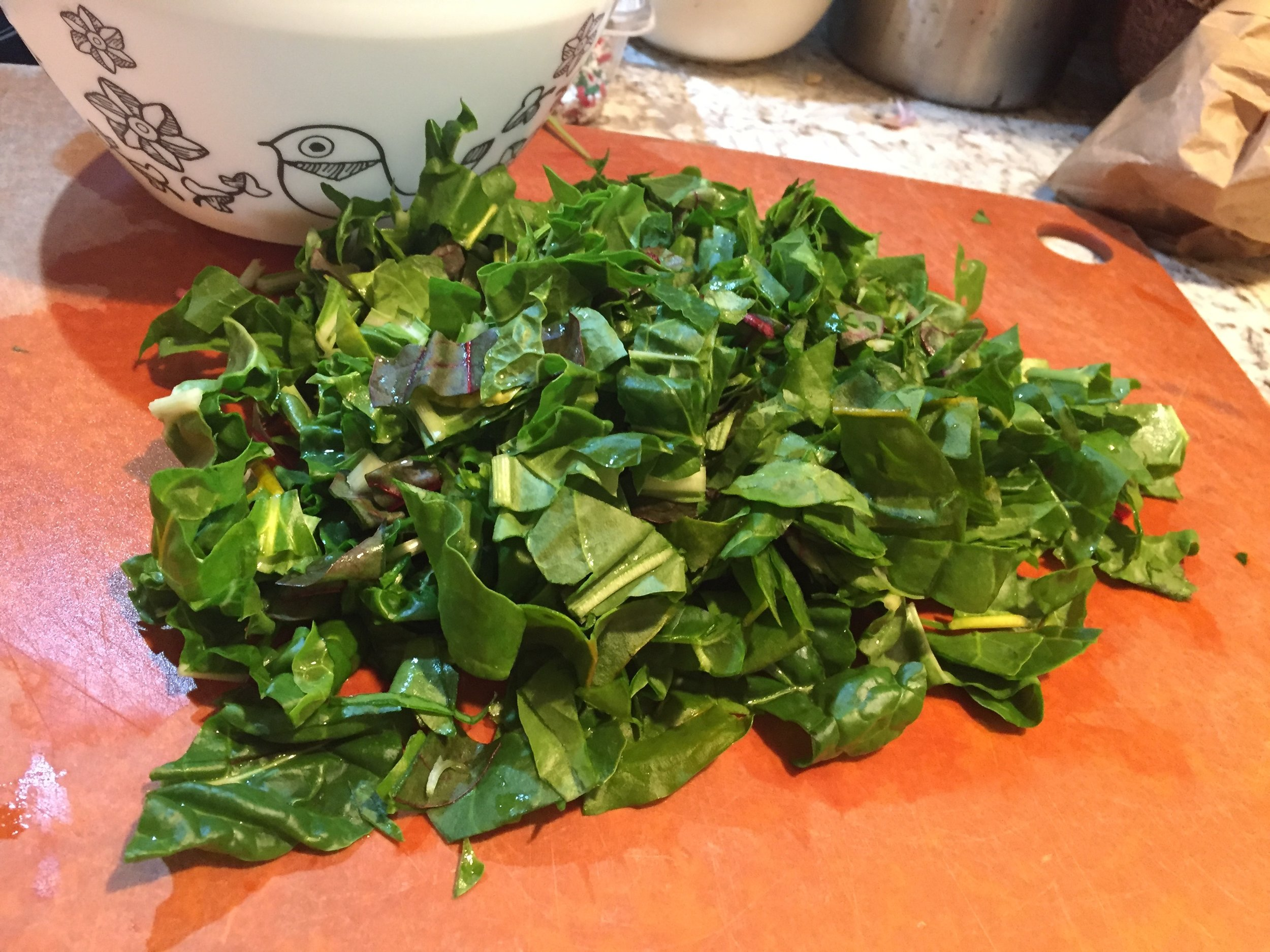 Baby Swiss chard, chopped roughly and ready to wilt in the sunny gingery dal.