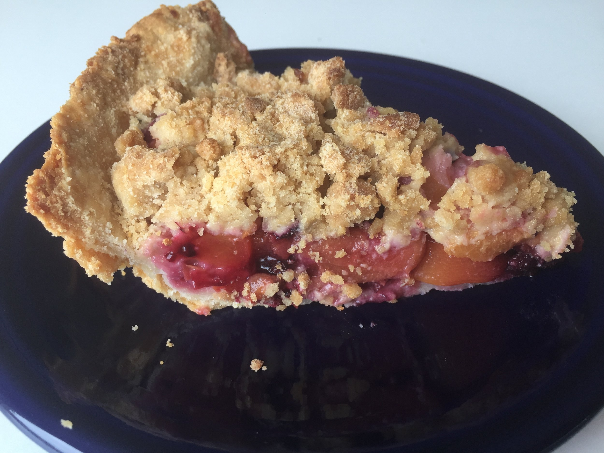 Berry and Stone Fruit Pie with peaches, cherries and black raspberries.