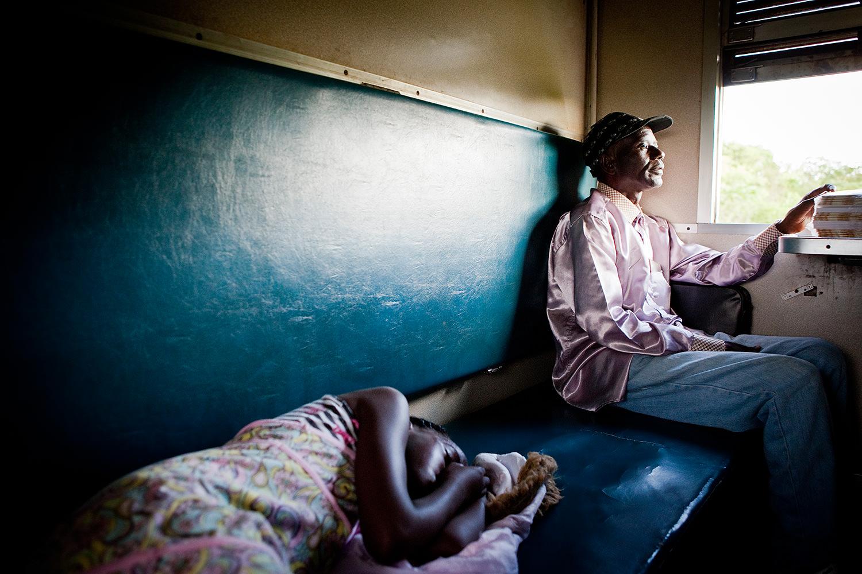 Tazara Express - Kid on an African train. Zambia
