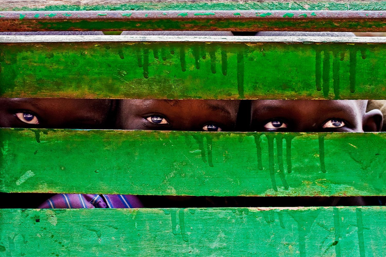 3 children playing behind a bench .Senegal-Isla of Goreè.