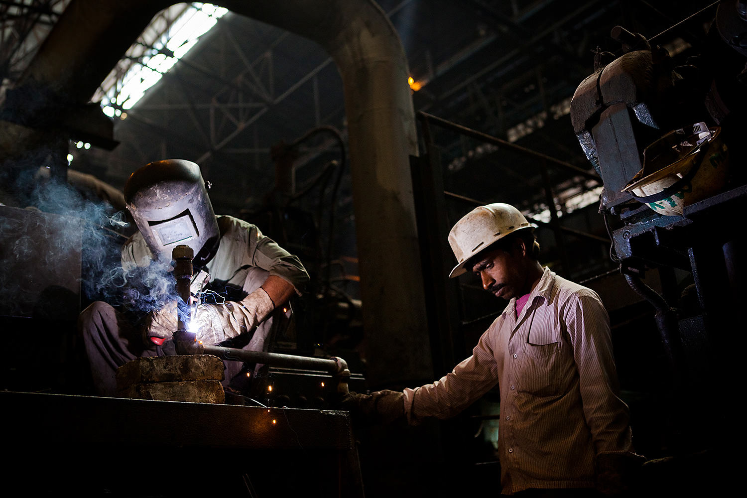 Two men working in a steel center in Bokaro- India