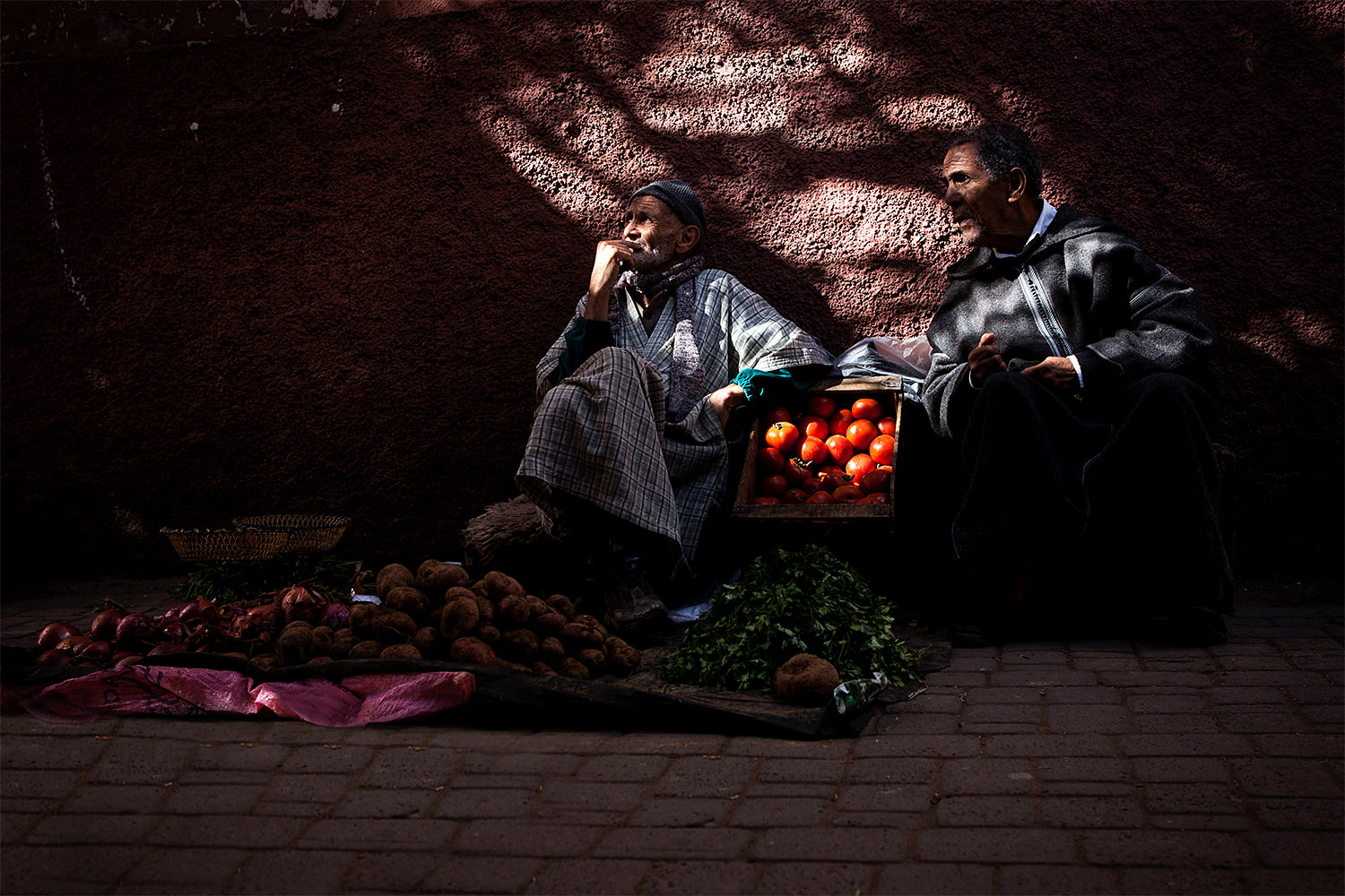 Two men in a souk in the center of Marrakech- Morocco