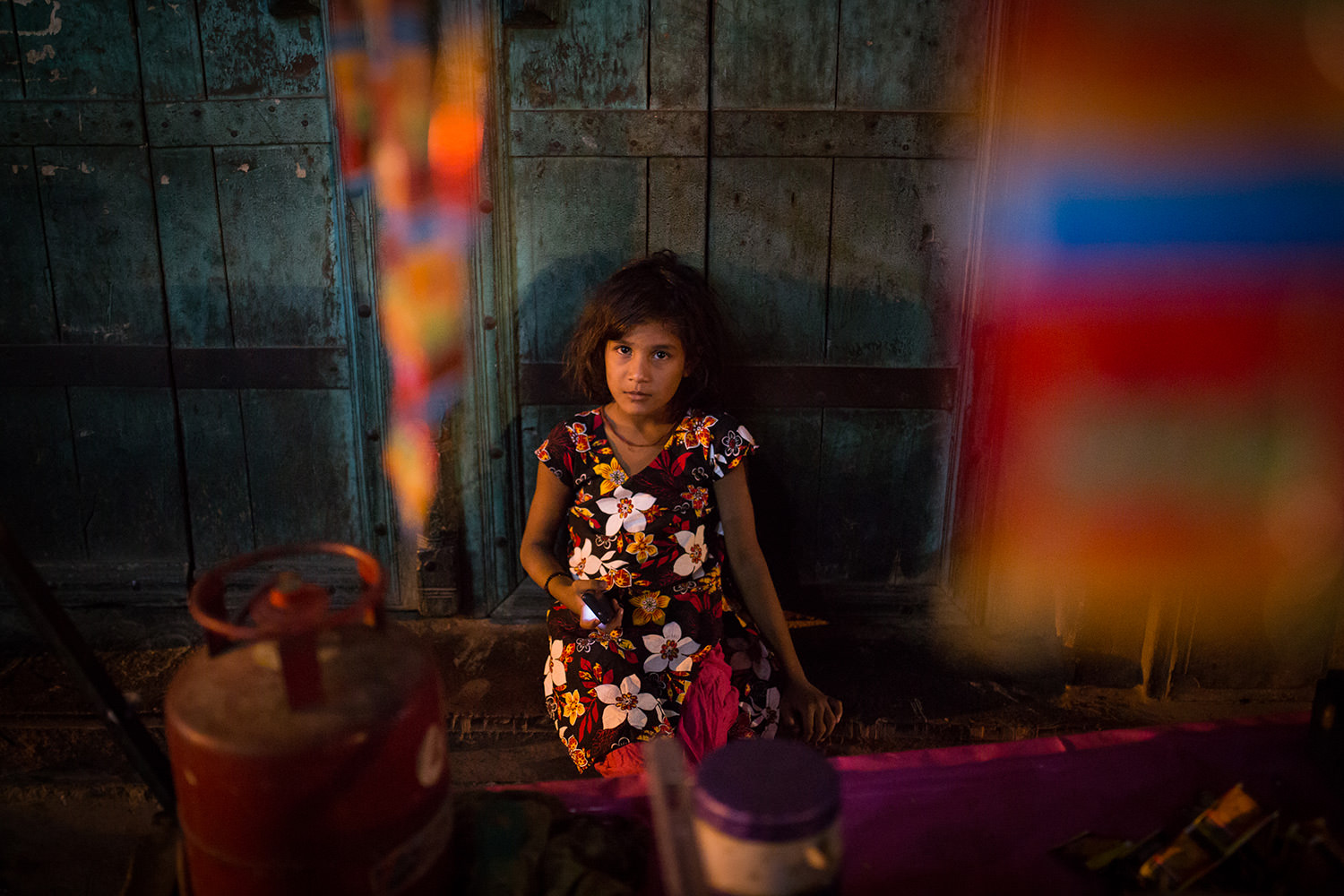 Portrait of a child with a flower dress in a Matura Market. Matura- India