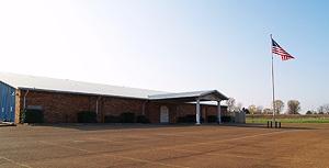 Desoto Shrine Club brick and blue siding building with metal room