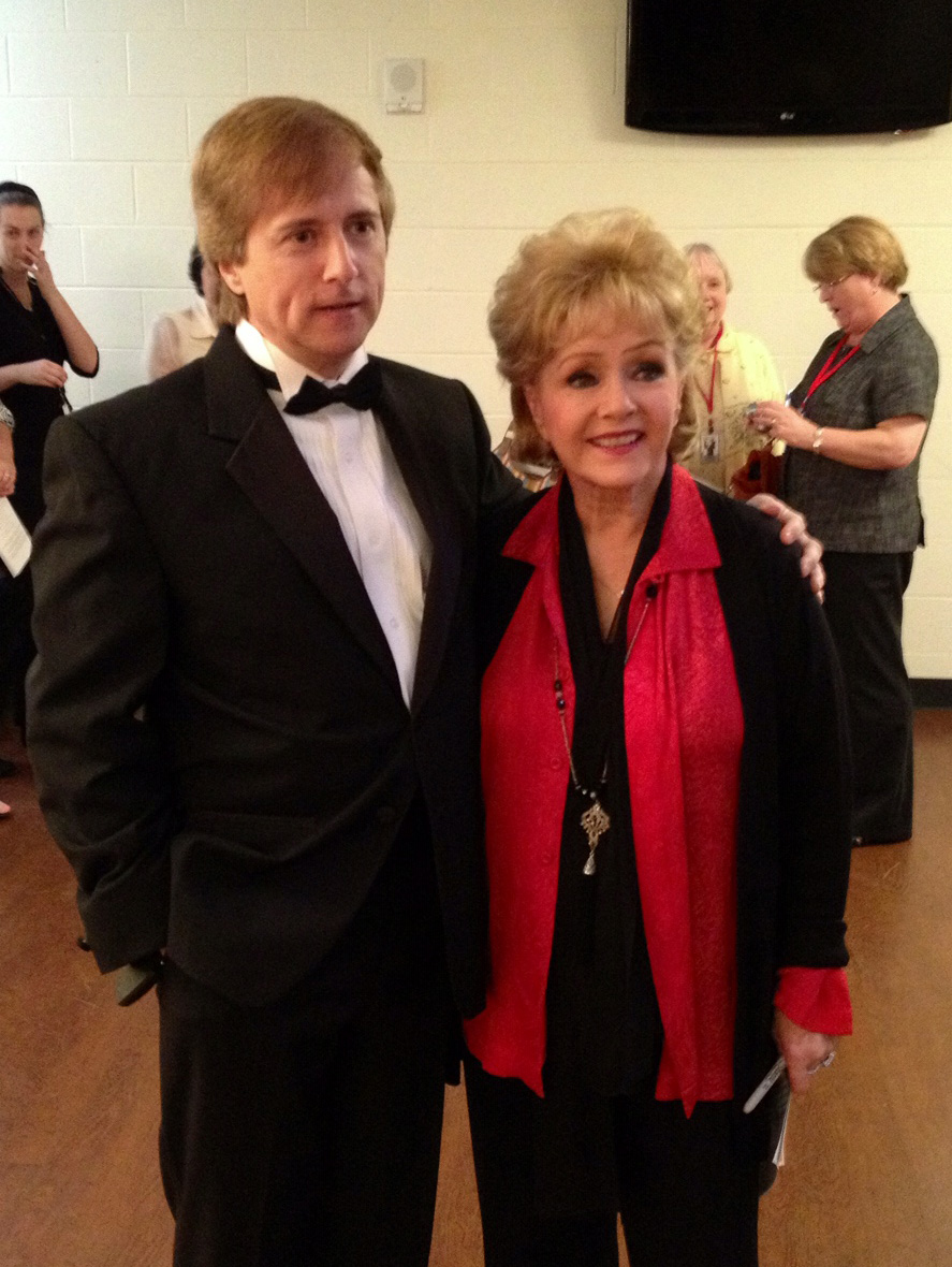 Peter Bezemes, the newly hired Executive Director of the Augusta Colonial Theater, pictured with actress Debbie Reynolds.