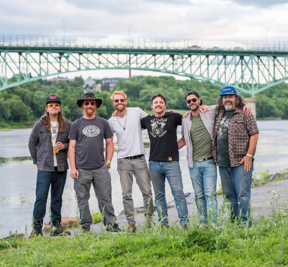The Mallett Brothers Band pictured here in front of the Kennebec River in Augusta, July 2018. Photo by Dave Dostie.