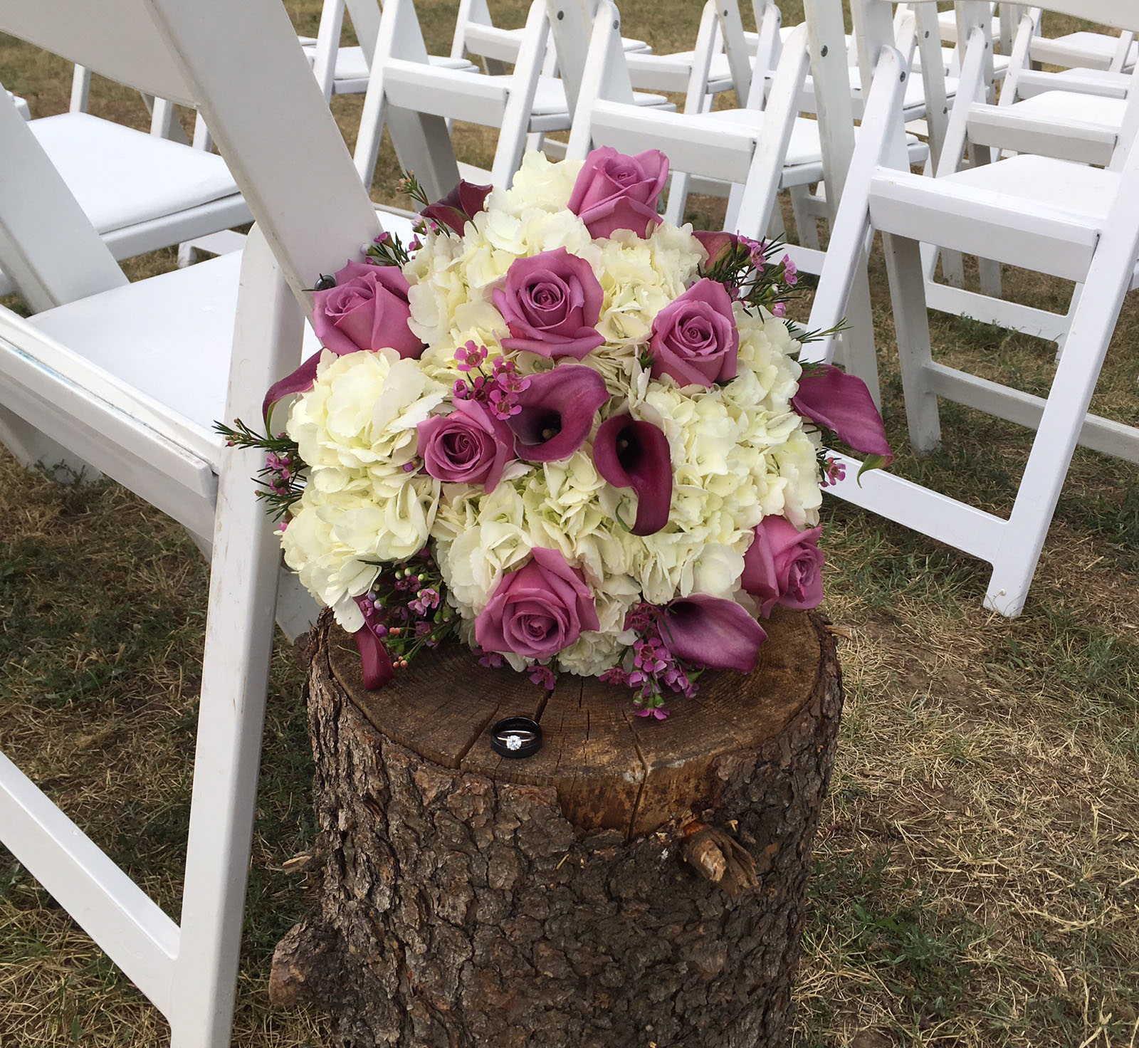 Flowers on stump at the end of the aisle.jpg