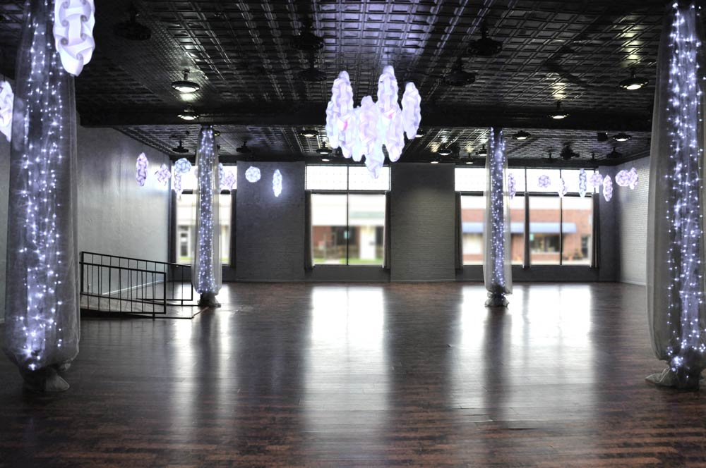 """Custom Color LED ceiling fixture lighting in 16 different color choices. The white lights on the columns stay white.   This room can seat up to 200 people. 23 - 60"""" round tables with 8-9 chairs around each table"""