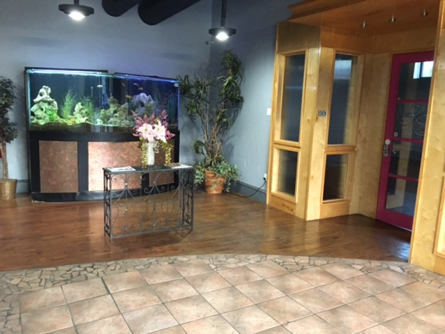 Venue Entrance  with 650 gallon fish tank. To the right is the small venue through the pink door