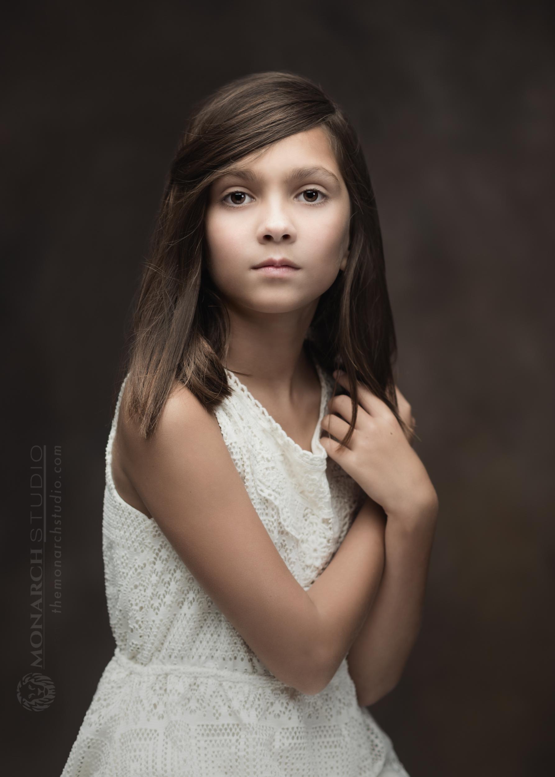 Fine art children's portraiture of girl in Florida photography studio.