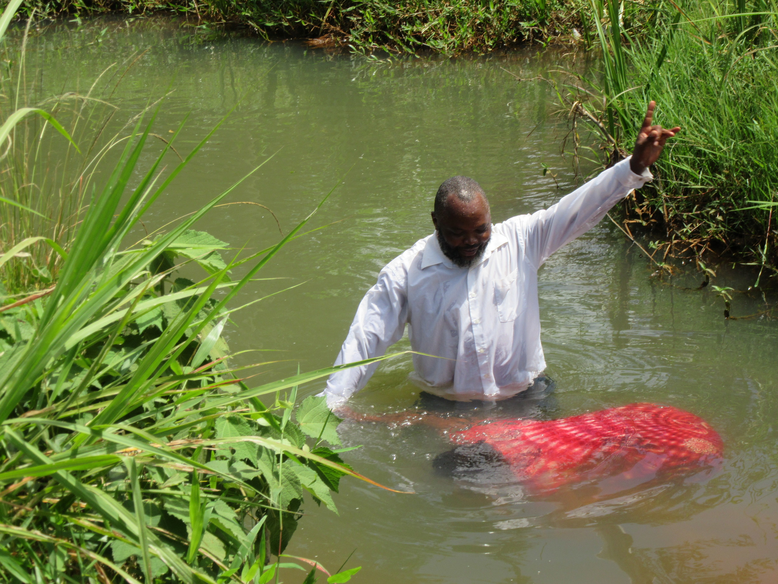 Baptism of Lucy Rwamba Njiki (the wife of Elder John)