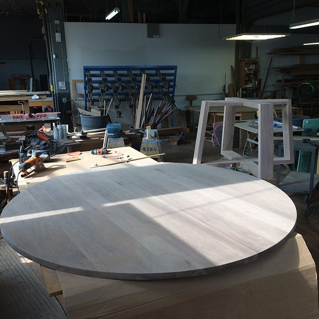 """Made the monster walnut panel a cleaner version of herself today. 72"""" diameters worth of sanding plus base. Nearly ready for finish. #cabinetmaker #cincymade #customfurniture"""