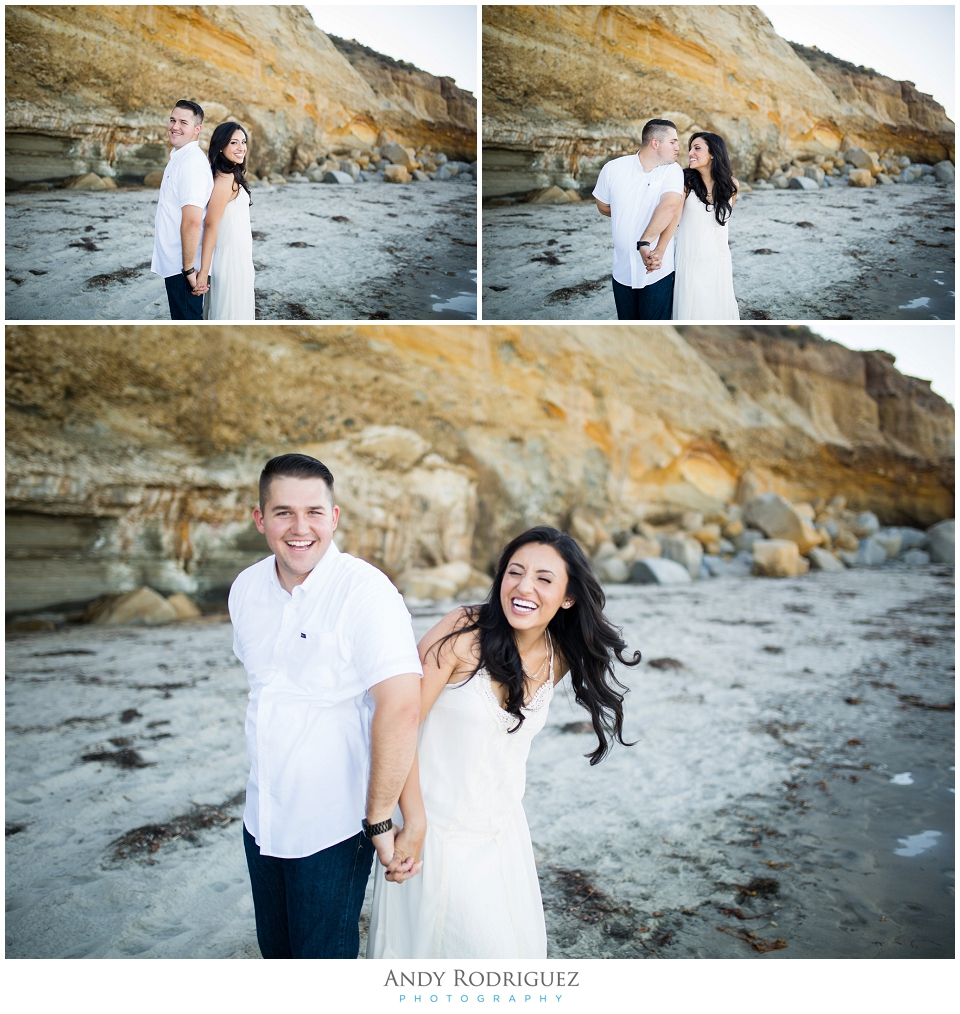 Bride and groom laughing at Scripps Beach