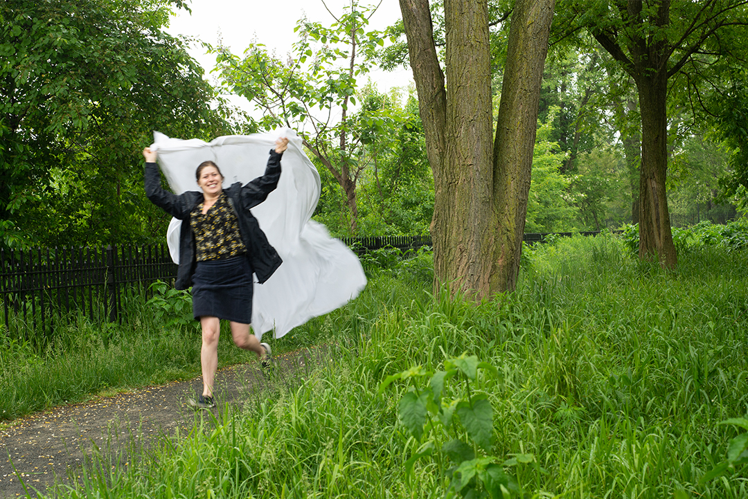 Laura being a super star fabric waver in the rain.