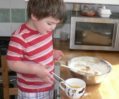 Joshua adds eggs to Herman.JPG