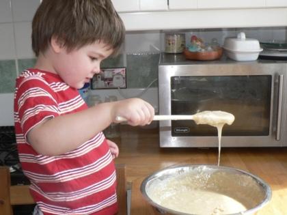 Joshua stirring Herman.JPG