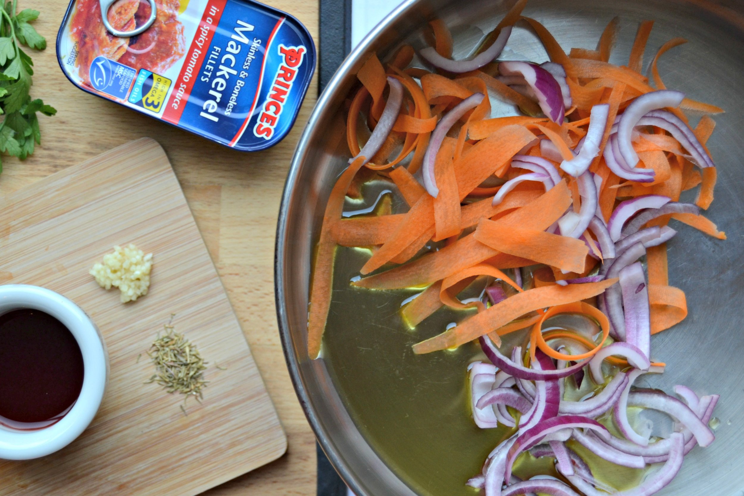 2.Add the onion and carrot. Cook for 3-4 minutes until just soft stirring frequently.