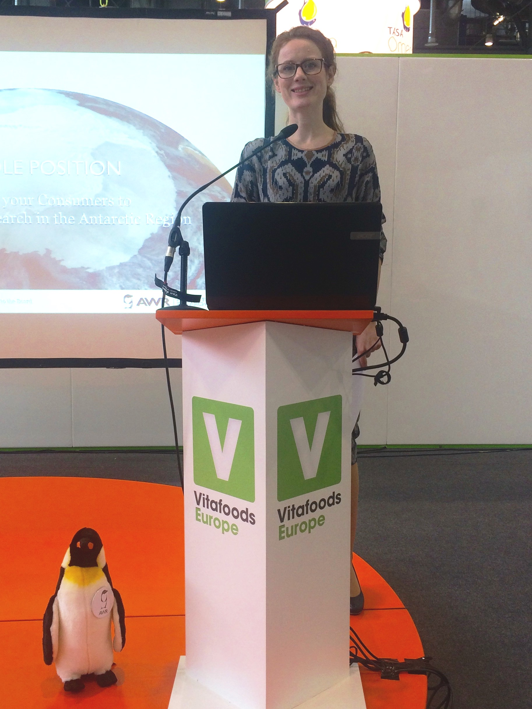 Marte Grindaker and the AWR Penguin presenting the Antarctic Wildlife Research Fund.