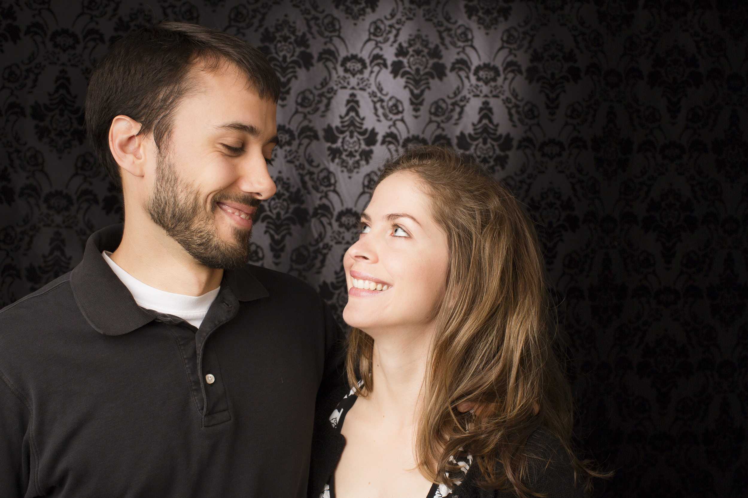 37 young couple family portrait studio session on black modern background.jpg
