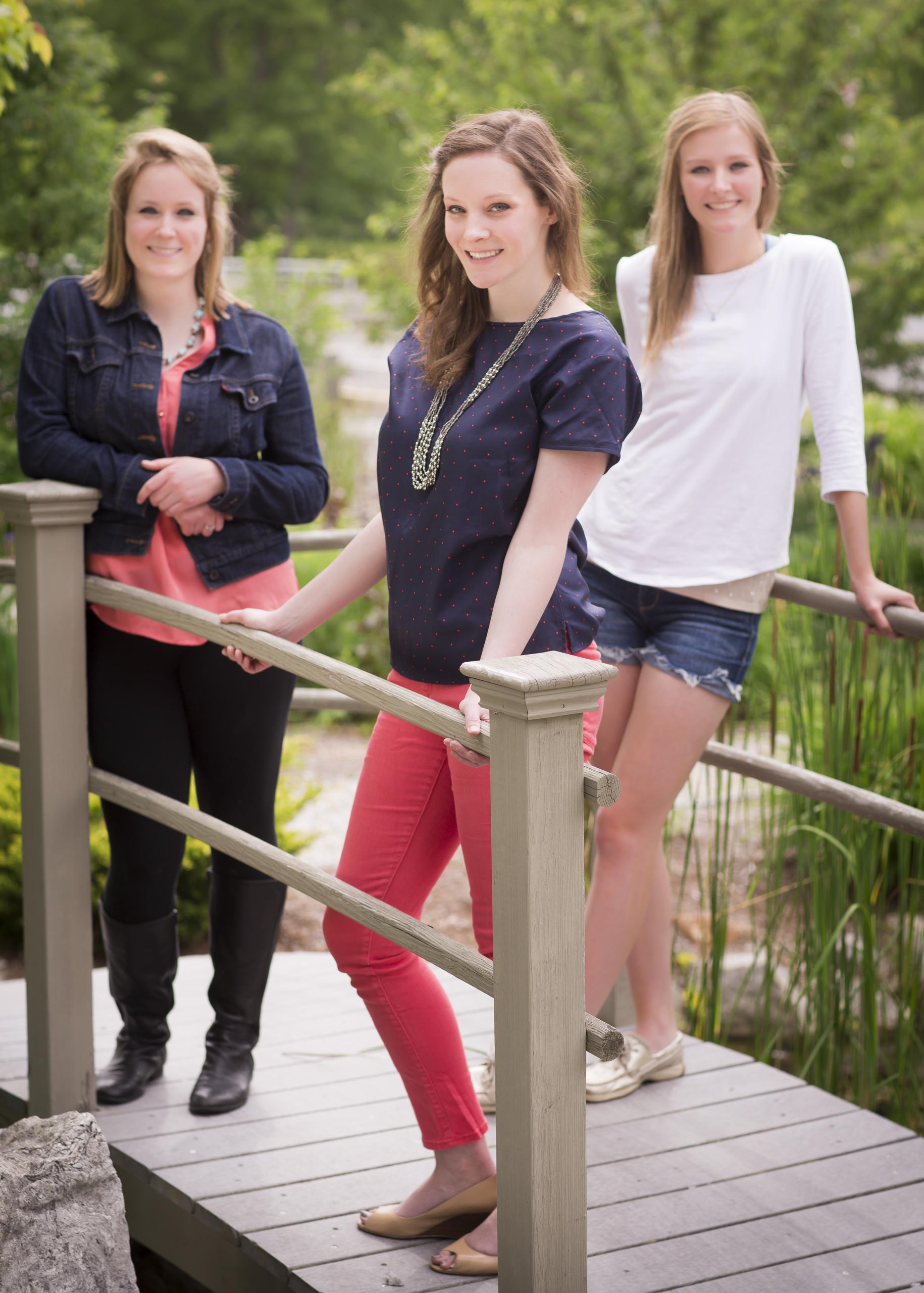 05 3 sisters family portrait outdoor session on bridge.jpg