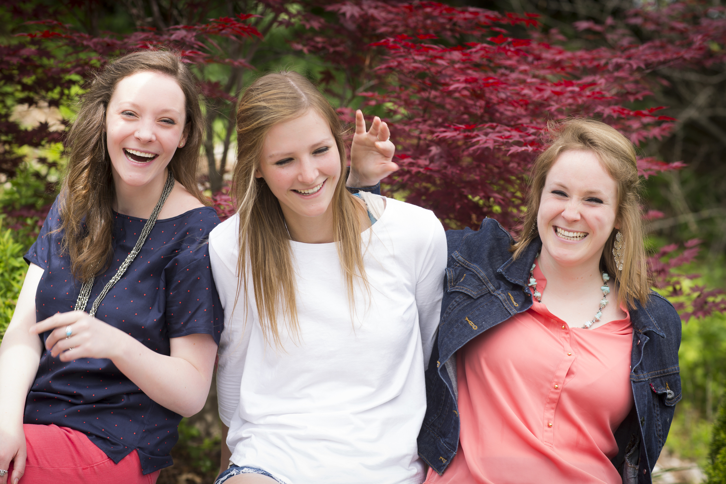 07 3 sisters family portrait outdoor session being silly maple tree.jpg