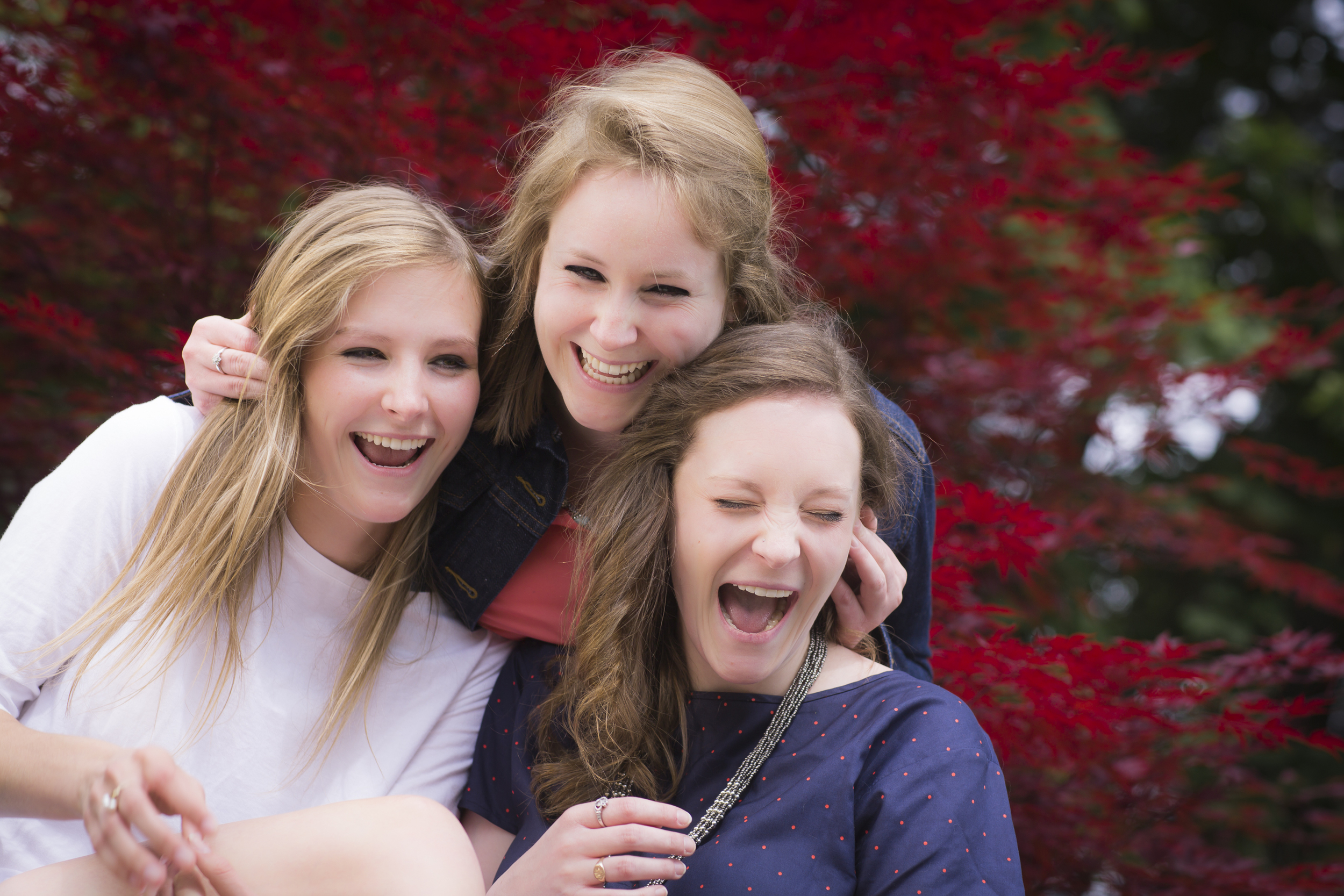 33 3 sisters family portrait outdoor session being silly red maple tree.jpg