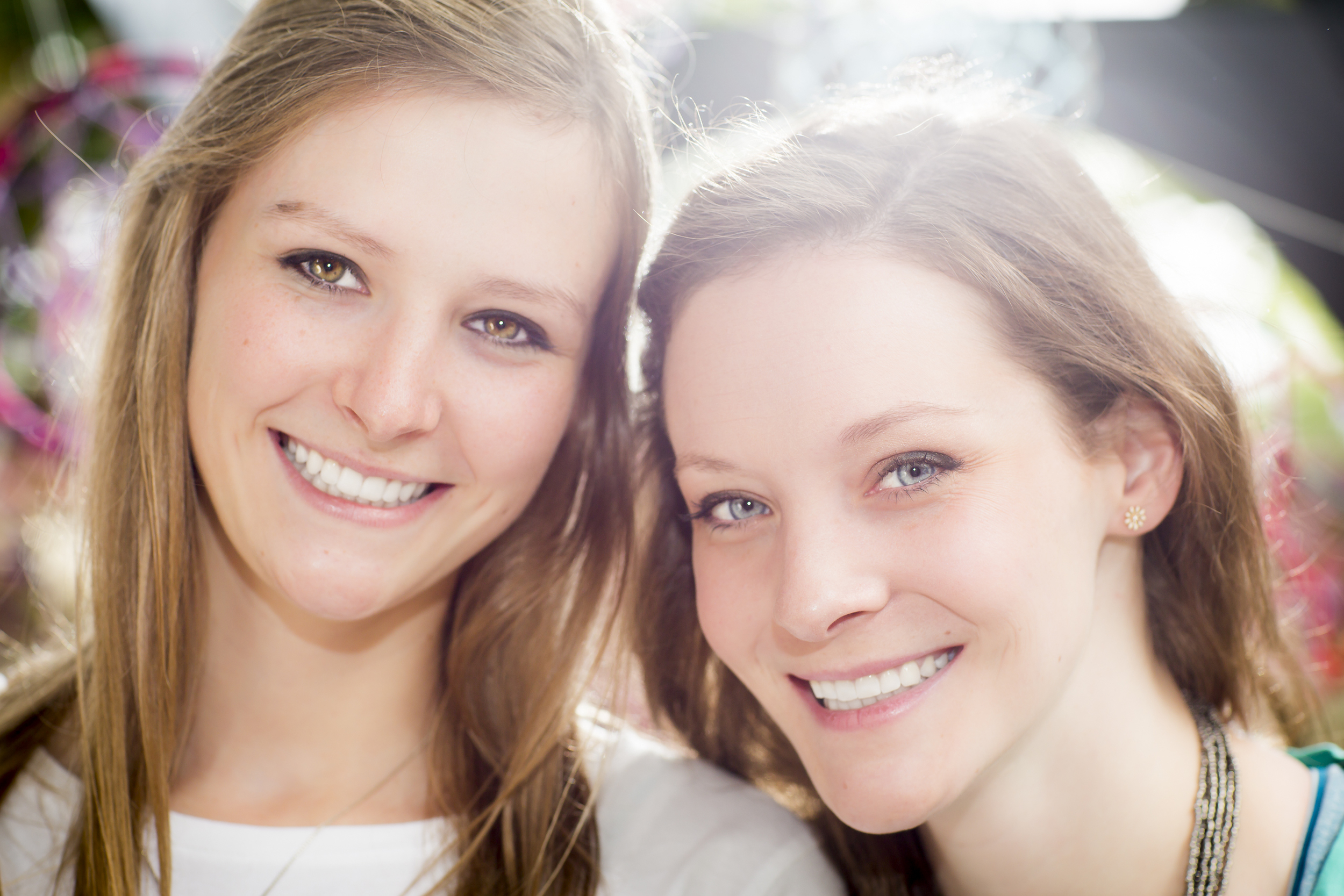 35 2 sisters family portrait outdoor session vibrant dream catchers up close.jpg
