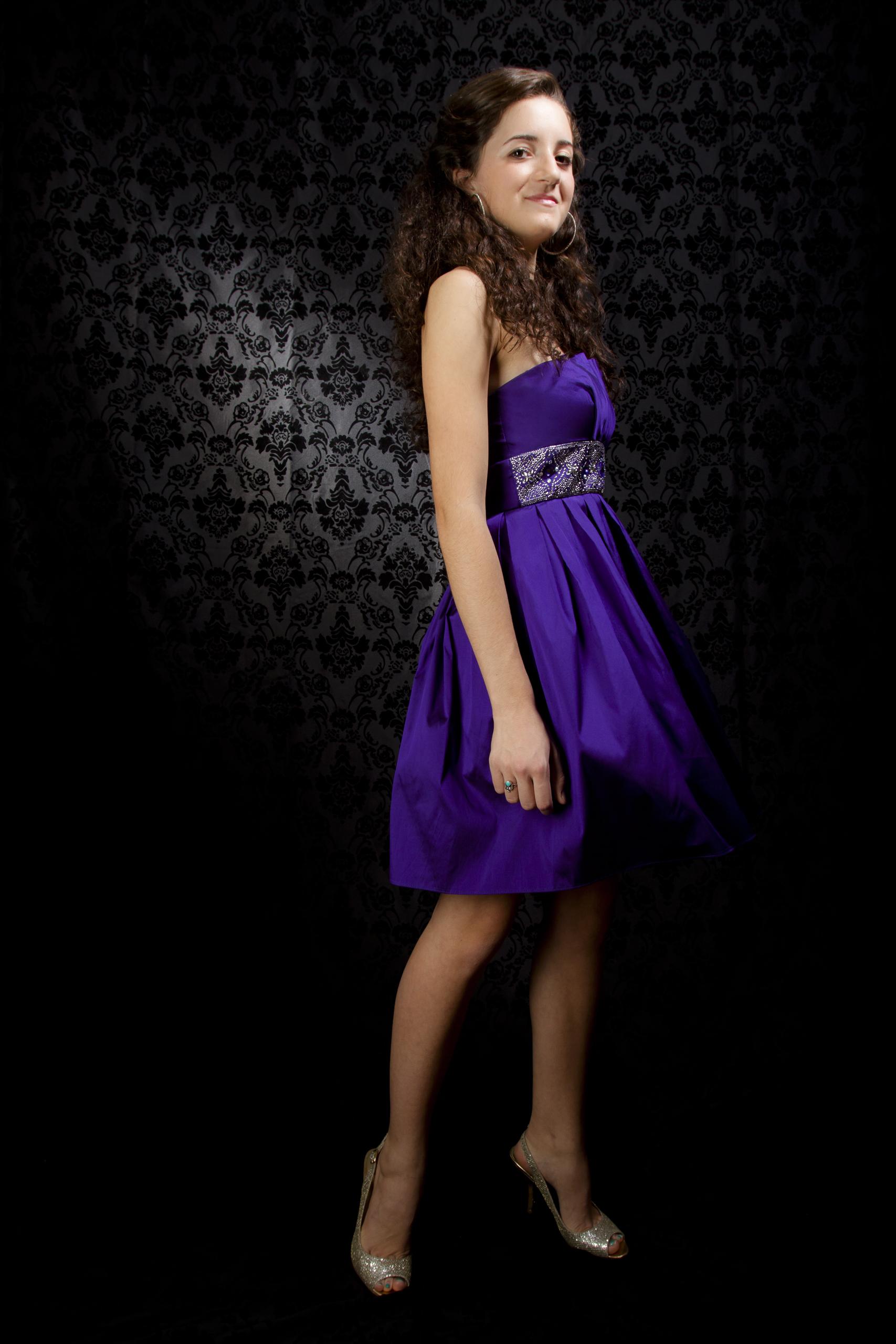 23 modern styled senior portrait session prom dress twirling on black background 8985.jpg
