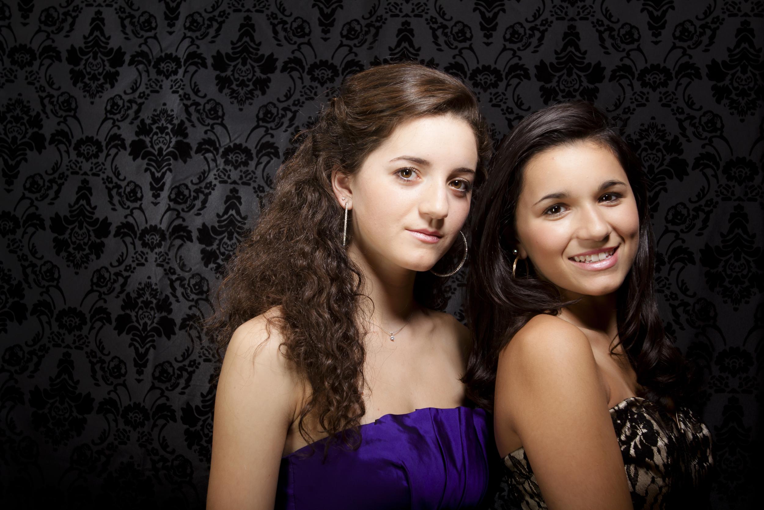 modern styled family portrait session prom dress sisters on black background 2.jpg