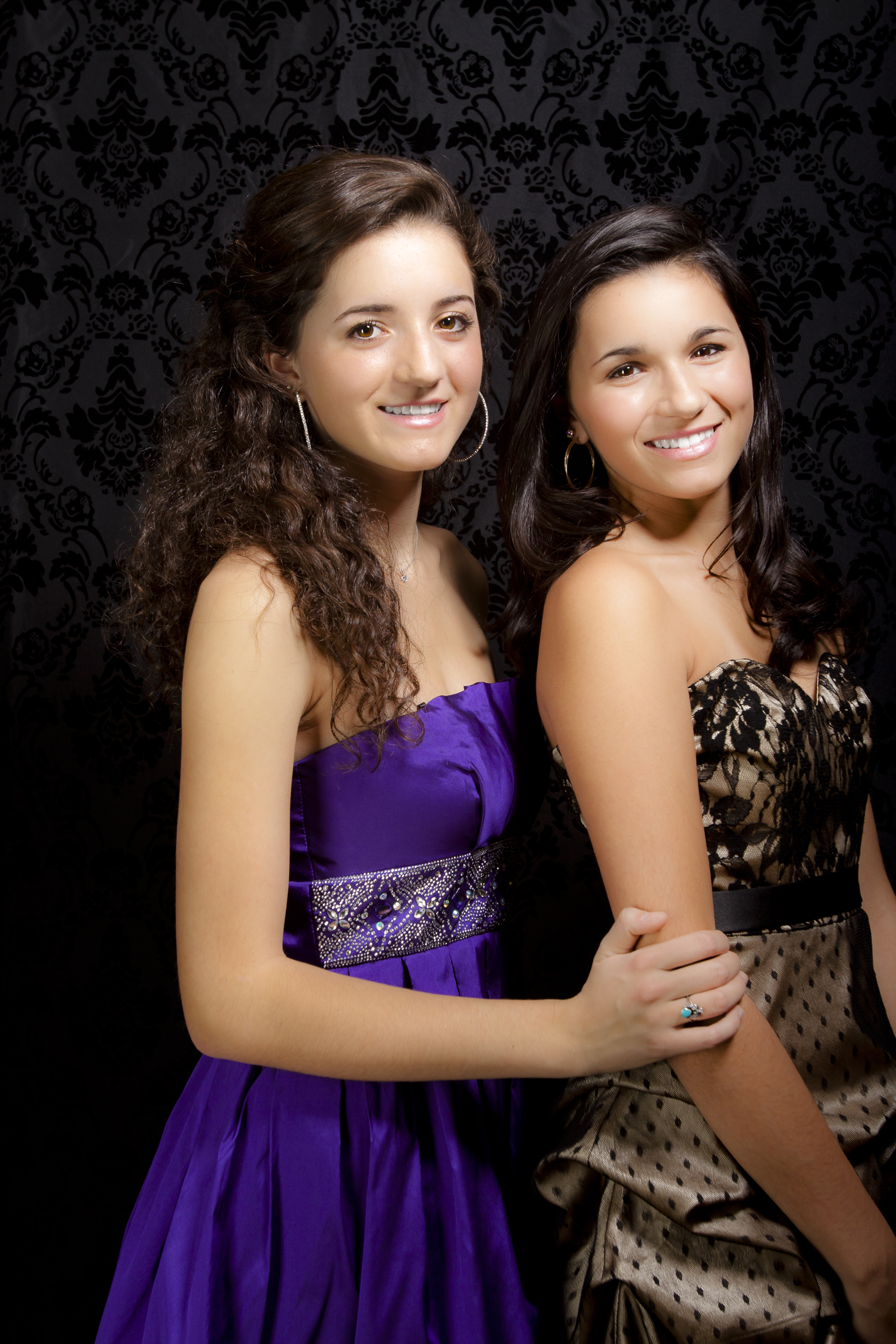 modern styled family portrait session prom dress sisters on black background 3.jpg