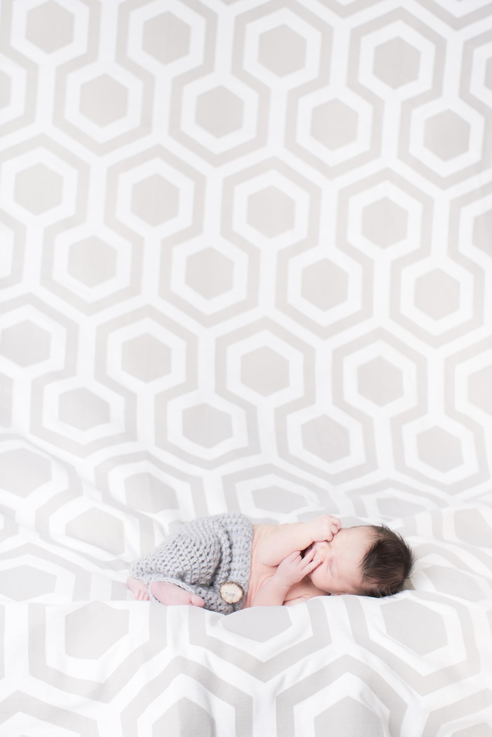 06 modern newborn baby boy in kint bottoms modern hexagon backdrop studio photography session.jpg