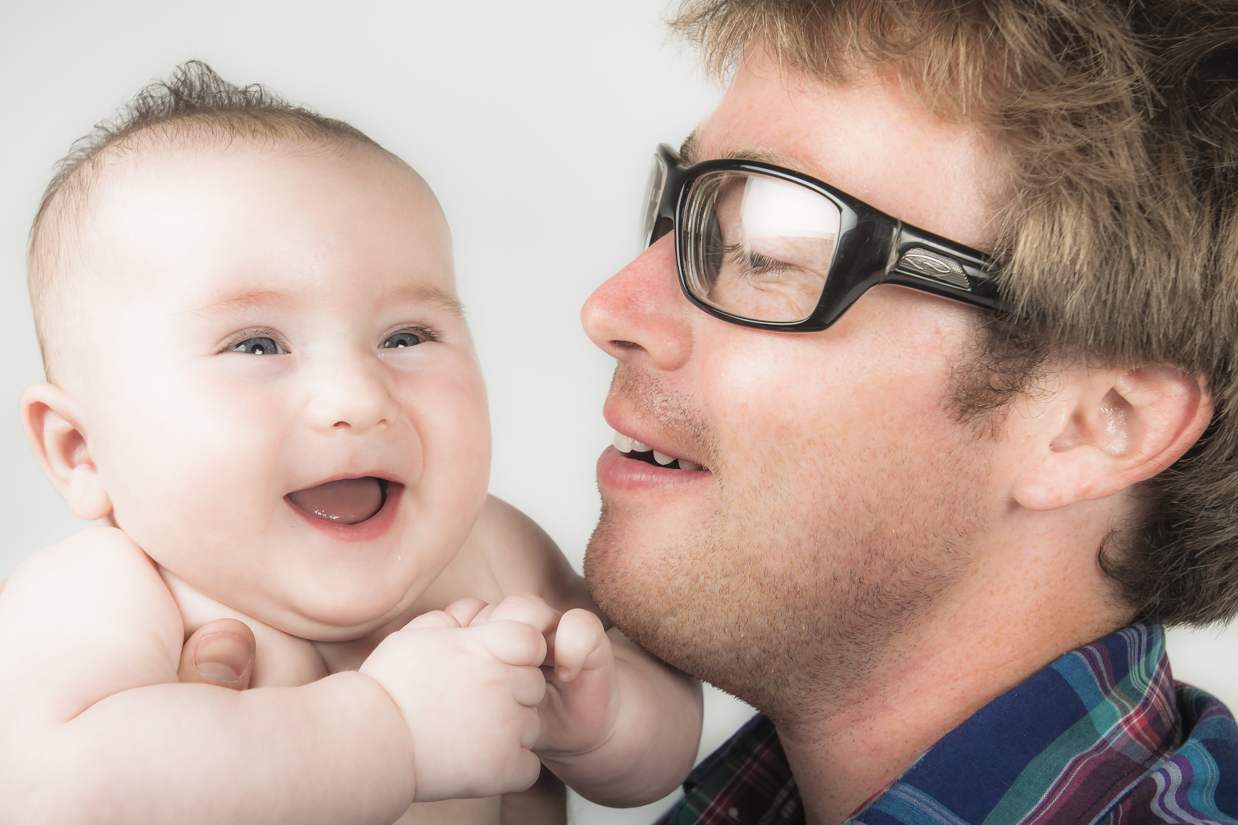 26 happy laughing modern baby with dad studio photography session.jpg