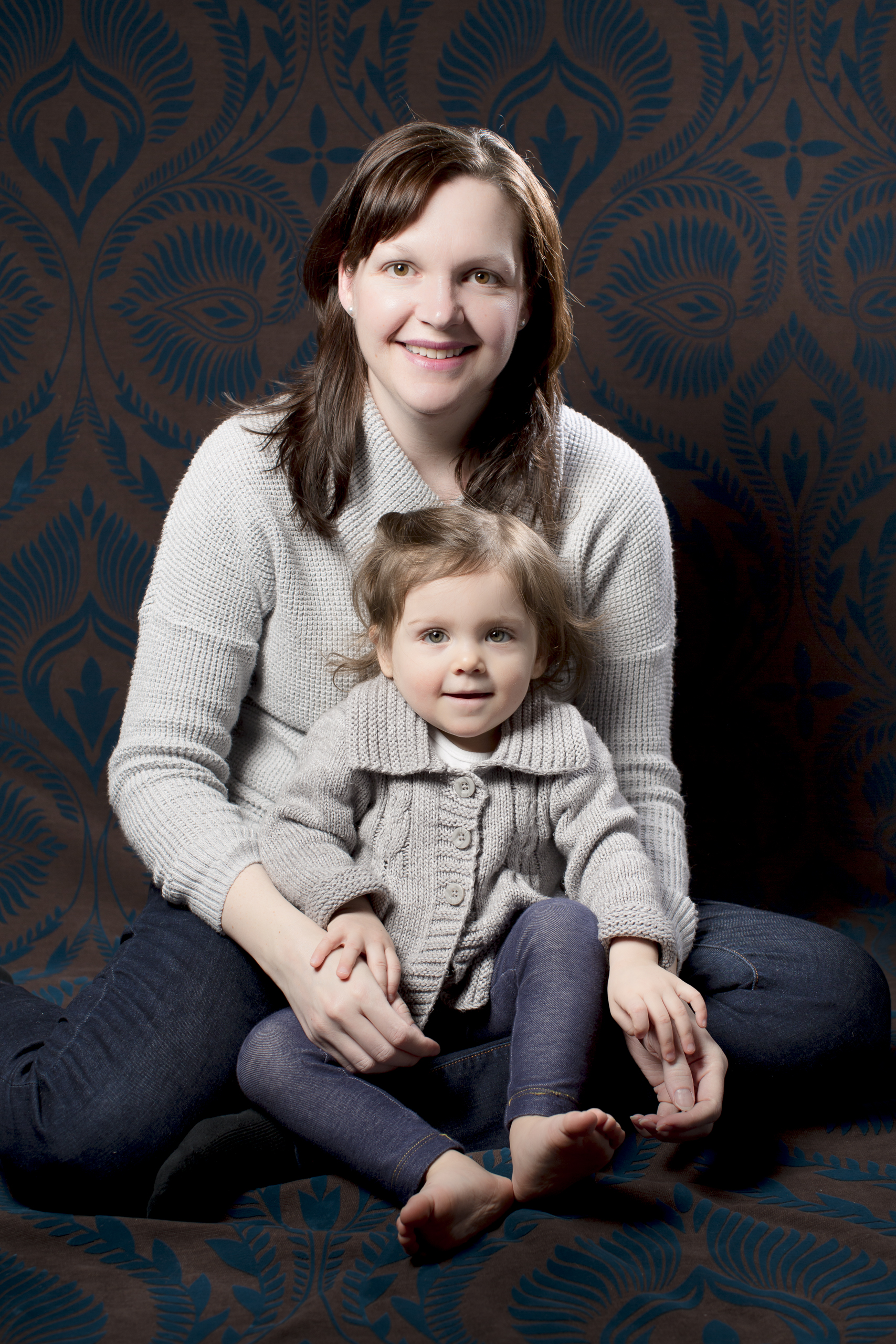 31 newborn baby momma and baby sister portrait photography session jeans and knit sweaters.jpg