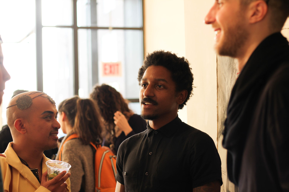 Myself, talking with Kiam Marcelo Junio, Chicago Artists Month feature artist and star of  Open TV Presents: Nupita Obama Creates Vogua , and Zac Hall, who designed floral arrangements for the event at Woman Made Gallery