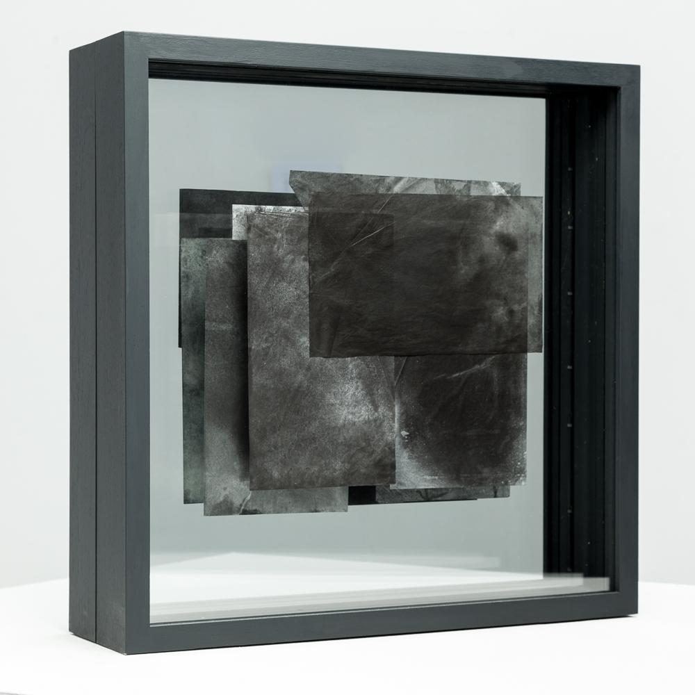 BLACK  Side 1: Pigment, oil, Japanese papers, glass, obeche, emulsion  51cm x 51cm x 14cm