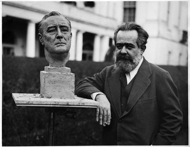 Jo Davidson with his bust of President Roosevelt at the White House in 1933.