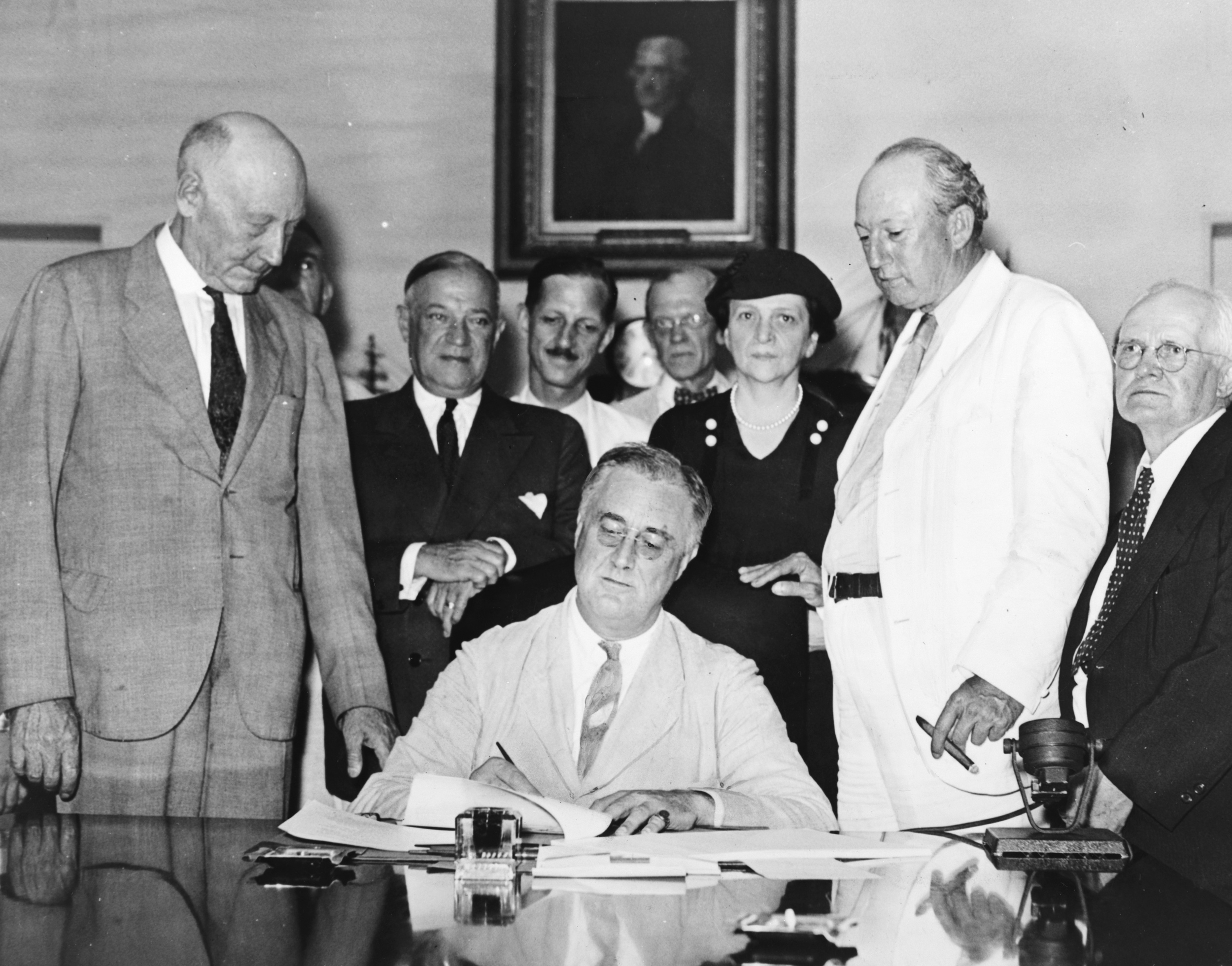 Secretary of Labor Frances Perkins, the only woman present asRoosevelt signed the Social Security Act in 1935. LOC