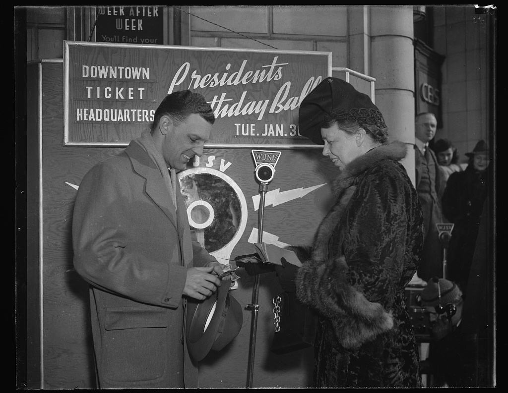Mrs. Roosevelt buys first ticket to president's Birthday Ball from WJSV announcer A.D. Jess Willard and made a short broadcast appealing for support of the function. Courtesy, LOC