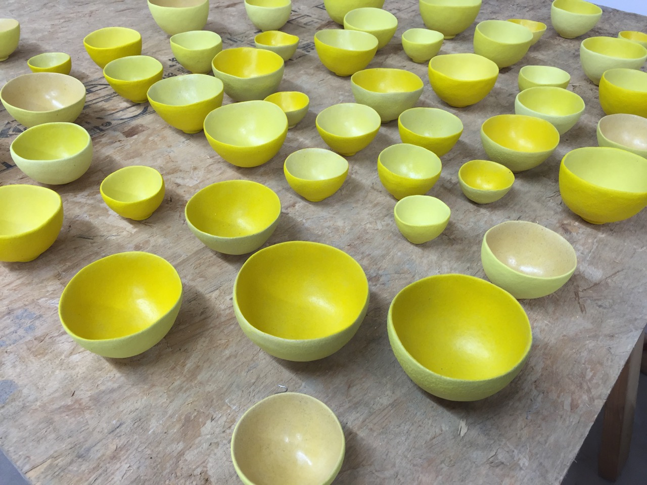 The bowls emerge from the kiln after the second firing.