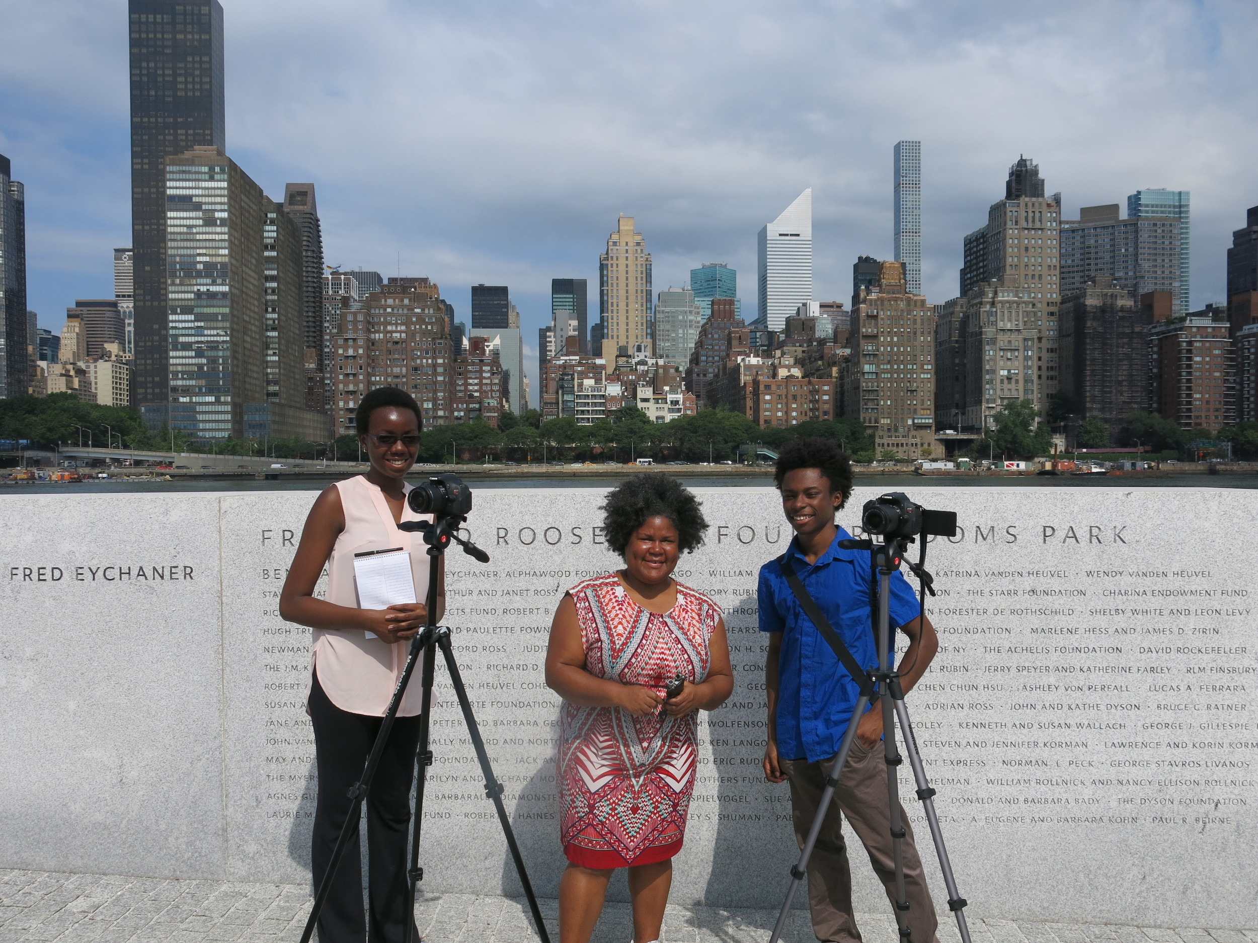 Interns Marie-Therese Ghunney (left) and Isaiah Lee (right) are working with documentary filmmaker Katherine Cheairs (center) to document stories from older New Yorkers. The interns are members of Studio in a School's Bloomberg Arts & Culture Internship Program.