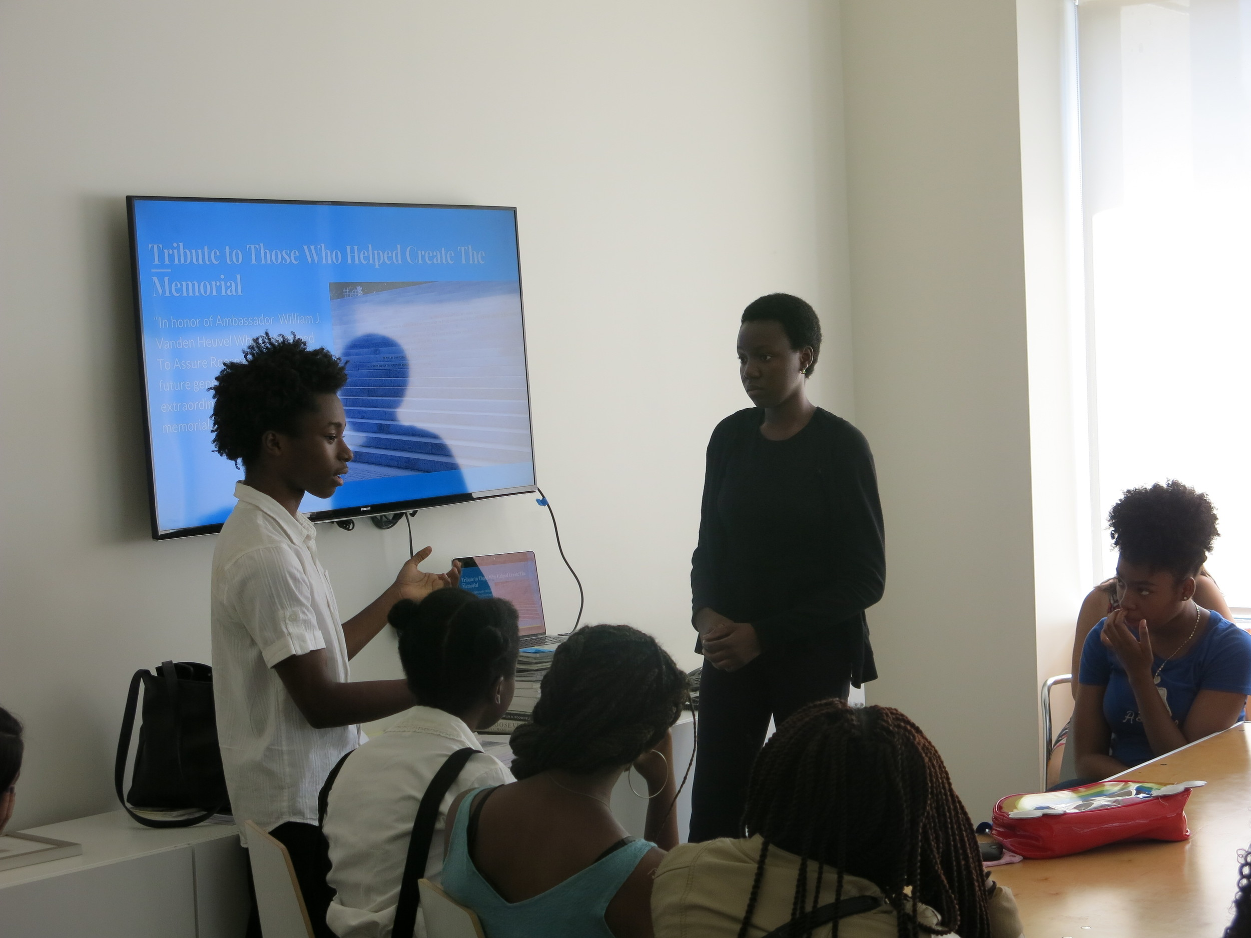Isaiah and Marie give a presentation on their work at the Conservancy to other students in the internship program.