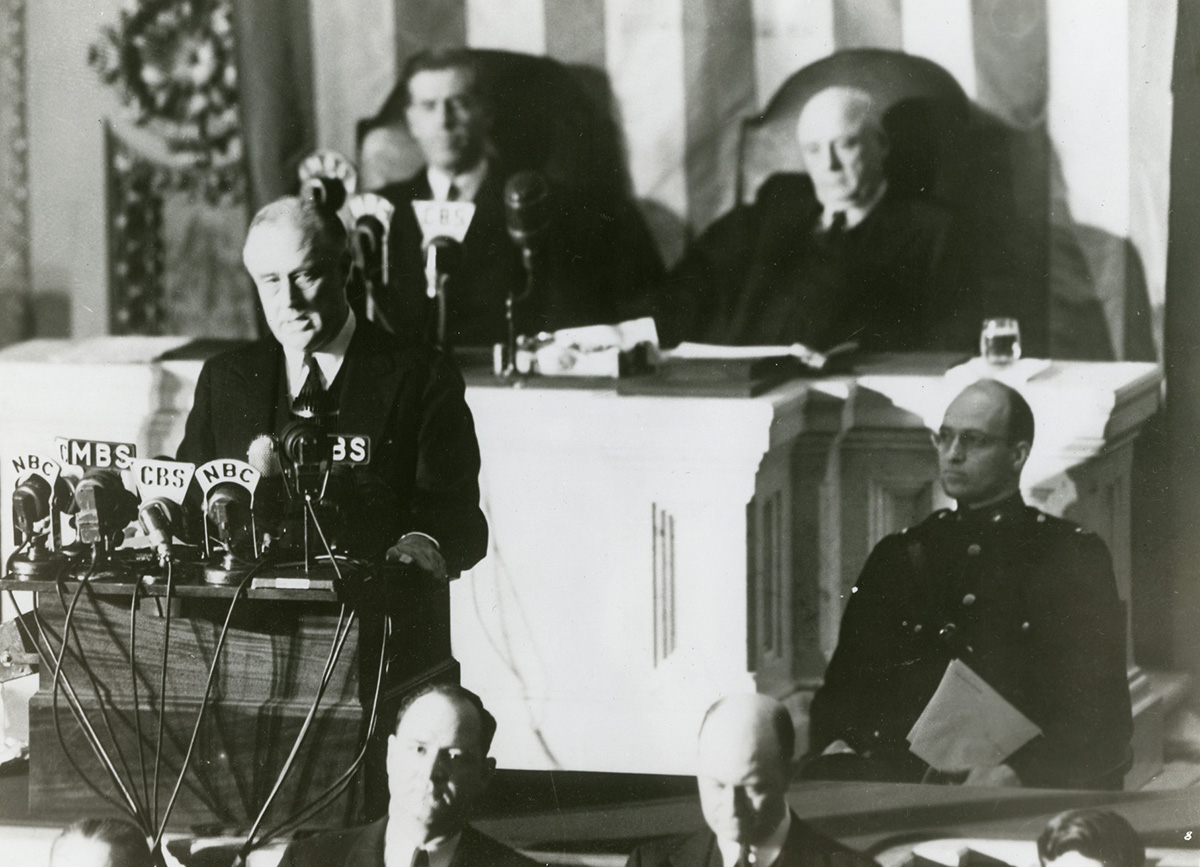 """Franklin D. Roosevelt addresses Congress on December 8, 1941, the day after the Japanese attacked a U.S. naval base in Pearl Harbor, Hawaii, killing some 2,400 Americans. """"I believe that I interpret the will of the Congress and of the people when I assert that we will not only defend ourselves to the uttermost but will make it very certain that this form of treachery shall never again endanger us,"""" FDR said. Congress approved a declaration of war against Japan with only a single dissenting vote. FDRL"""