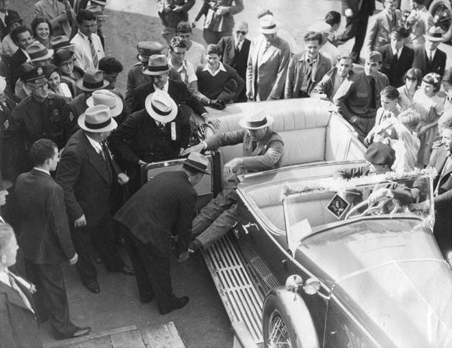 Rare photograph of FDR showing him being assisted out of his car, 1932.