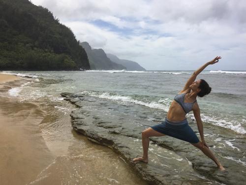 Striking a (Reverse-Warrior) Pose on Ke'e Beach, Na'Pali Coast in the background