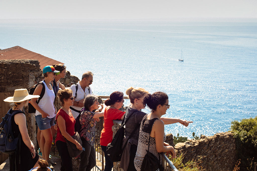 A group of Ananda Travelers on the  Tuscan Countryside Yoga Adventure  take in the views from the hike between Monterosso al Mare and Vernazza in Cinque Terre, Italy.