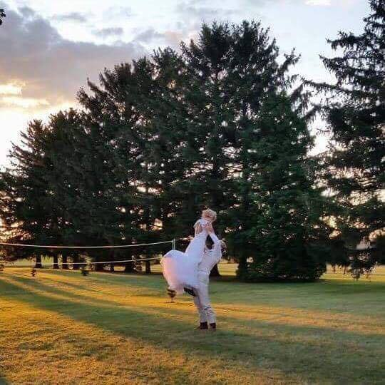 The first one, I saw the golden sun setting and grabbed my bride and groom for a quick few photos. A guest captured some photos on their cell phone at the same time, while the image they took is still beautiful, it failed to capture that golden sun!