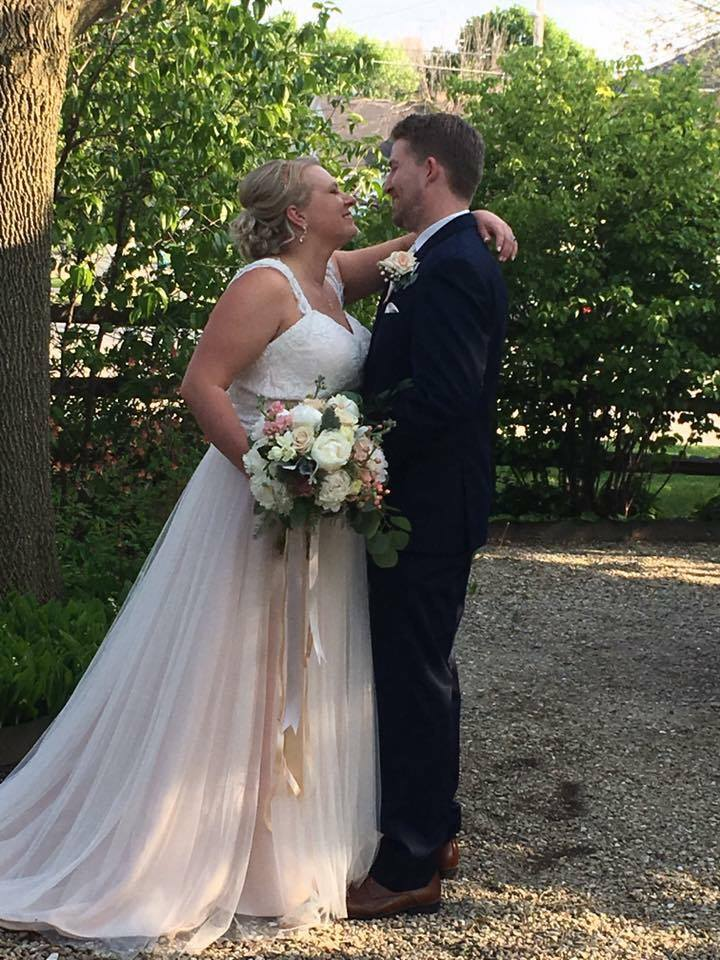 This second one, I posed my couple and then proceeded to shoot through a lilac bush. I know I probably looked crazy to the guest who took this image, but I had a vision! It's the little things!