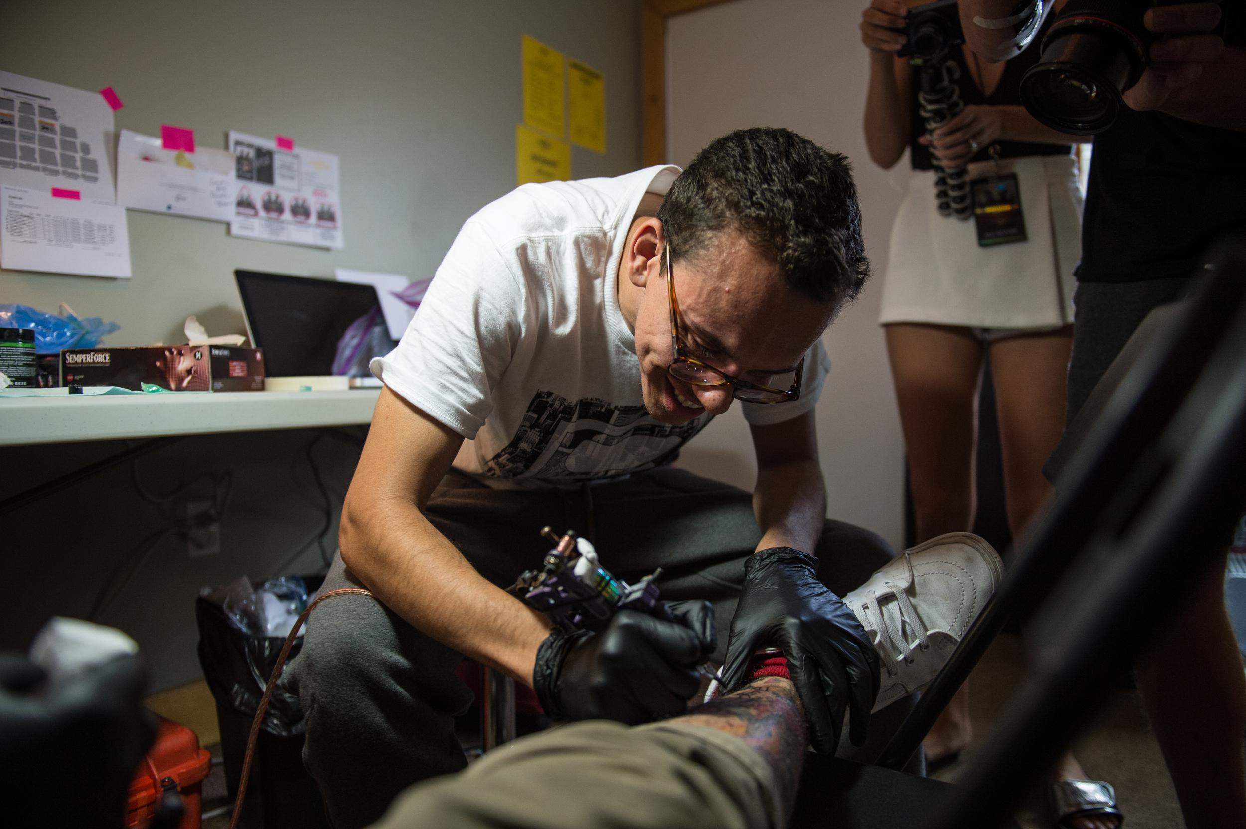 Logic tattooing the tattoo artist