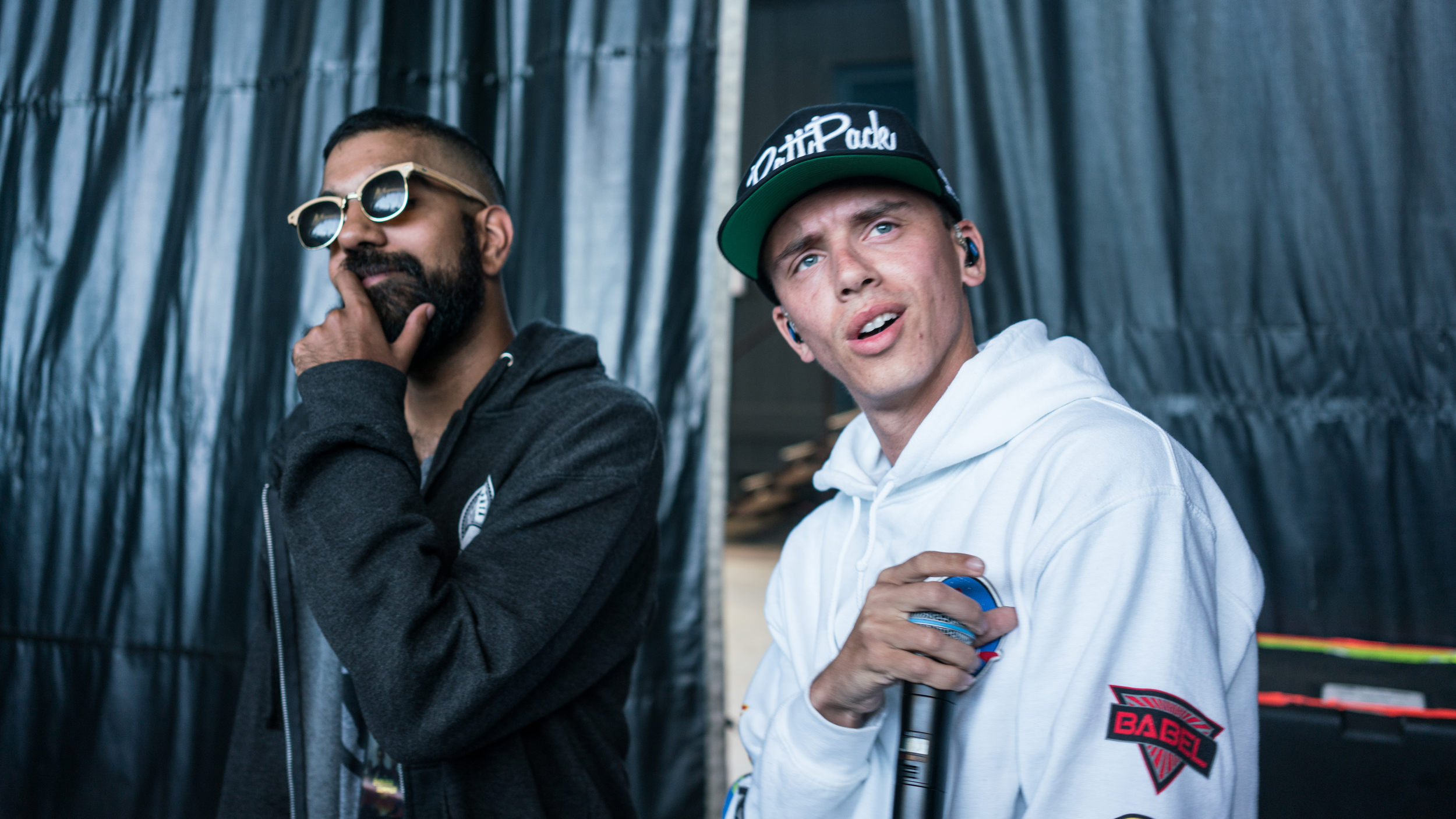 Logic and 6ix backstage before a show in Sacramento